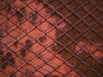 Rusty fence. Metal rusty grid old fence close-up royalty free stock photos