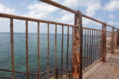 Rusty fence near the sea Royalty Free Stock Photography