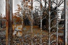 Rusty fence of an old garden stock photos