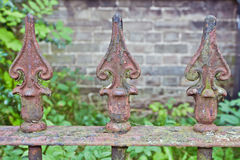 Rusty fence spikes. Close up of rusty metal fence spikes Royalty Free Stock Image