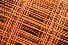 Rusty fencing material. Close-up of rusty fencing material laying in some hay on a farm royalty free stock photo