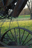 Rusty Field Gear. An old threshing machine sits in a field on a late spring afternoon Stock Photos