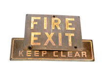Rusty Fire Exit Sign Isolated on White Background. Rusty, aged and weathered Fire Exit sign isolated on a white background Royalty Free Stock Image