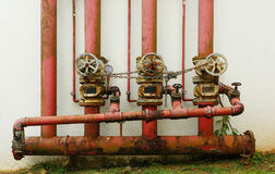 Rusty fire fighting pipeline system locked by metal chain Stock Image