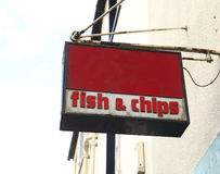 Rusty fish and chips sign Stock Image