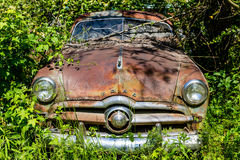 Rusty Ford in Weeds Stock Photos