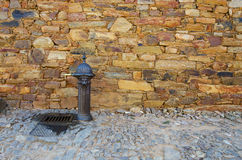 Rusty Fountain. Front of a stone wall Royalty Free Stock Photo