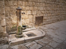 Rusty fountain in Oldtown of Molfetta. Apulia. Stock Photos
