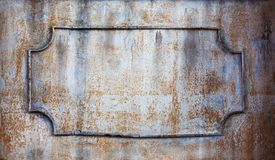 Rusty frame with decorative forged iron elements. Copy space sgallow depth of field.  stock photography