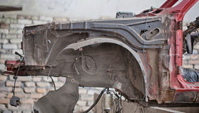 Rusty front wing on crashed car.  Royalty Free Stock Images