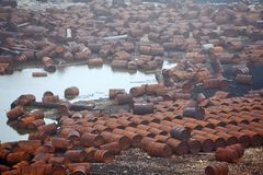 Rusty fuel and chemical drums royalty free stock image