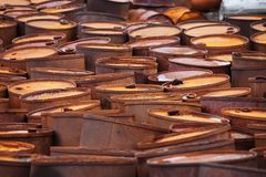 Rusty fuel drums on Arctic coast Stock Photo