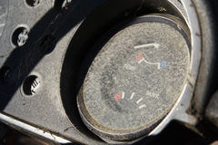 Rusty fuel gauge on vintage car control panel Stock Photography