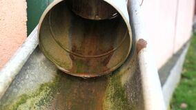 Rusty galvanised sheet metal pipe for drainage. Old zinc drain pipe. Rest of surface coating