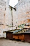 Rusty garages and a wall without windows. In the downtown of Saint Petersburg stock photos