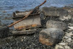 Rusty garbage by the ocean stock photos