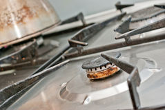 Rusty gas burner. Old gas burner and stove that needs to be checked stock images