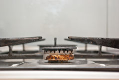 Rusty gas burner. Old gas burner and stove that needs to be ckecked stock photo
