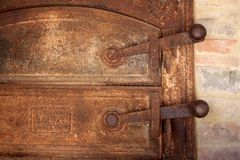 Rusty gate of an old oven Stock Photo