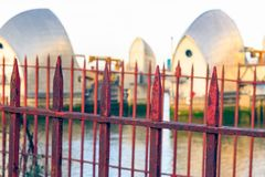 Rusty gate with Thames Barrier in the background royalty free stock image