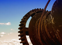 Rusty gear. Cog wheel or gear represent the metaphor of an old industry Stock Image