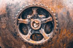 Rusty gear closeup, rusty ancient mechanism stock images