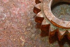 Rusty gear fragment. Closeup rusty gear fragment on the grunge metallic surface Royalty Free Stock Photo