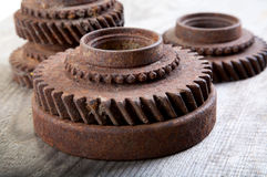 Rusty  gear wheels on a board Royalty Free Stock Image