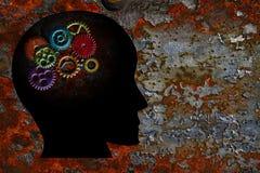Rusty Gears auf menschlicher Kopf-Schmutz-Beschaffenheits-Hintergrund Stockfotografie