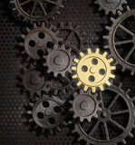 Rusty gears and cogs with gold one Royalty Free Stock Images