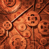 Rusty Gears. Image of rusty gears against a metallic background Stock Photography