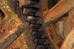 Rusty gears in old machine equipement. Two rusty old gears lined up from an old saw mill Royalty Free Stock Image