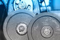 Rusty gears of the old mechanism. Blue toning. Rusty gears of the old industrial mechanism. Blue toning royalty free stock photography