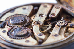 Rusty gears in an old pocket watch Royalty Free Stock Images