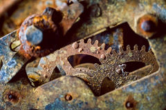 Rusty gears. Rusty and old watch gears close up Stock Photo
