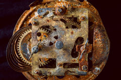 Rusty gears. Rusty and old watch gears close up Stock Image