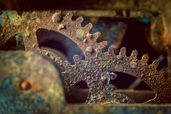 Rusty gears. Rusty and old watch gears close up stock images