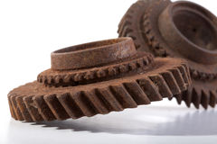 Rusty gears on a white background. Isolated Royalty Free Stock Photo