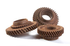 Rusty gears on a white background. Isolated Stock Photography