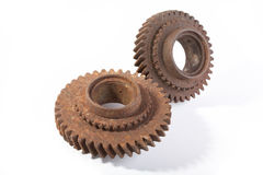 Rusty gears on a white background. Isolated Stock Image