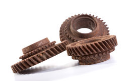 Rusty gears on a white background. Isolated Royalty Free Stock Photos