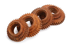 Rusty gears  on white. Background Stock Photos