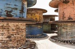 Rusty Giant Spools en Spoelen Stock Foto's