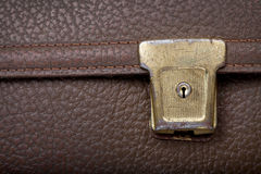 Rusty golden lock on brown leather school bag Royalty Free Stock Images