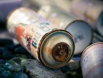 Rusty Graffiti Cans Arkivfoton