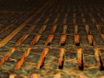 Rusty grate. Very rusty lattice of drainage system Royalty Free Stock Photography