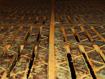 Rusty grate. Very rusty lattice of drainage system Royalty Free Stock Photos