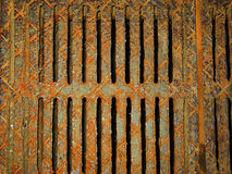 Rusty grate. Very rusty lattice of drainage system Royalty Free Stock Images