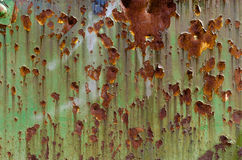 Rusty Green. Sheet metal, painted green, with signs of rust. Background Royalty Free Stock Photo