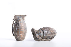 Ancient and rusty grenades. Rusty grenades on white. old Weathered ammunition Royalty Free Stock Image